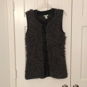 Statement sweater vest with faux leather trim.